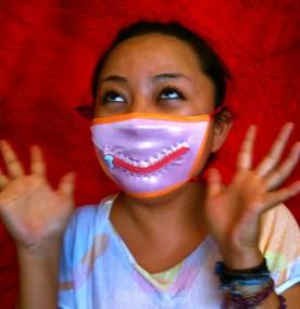Danielle in a pink zipper mask