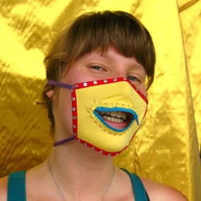 Hannah in a yellow mask