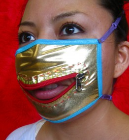 Danielle in a gold mask